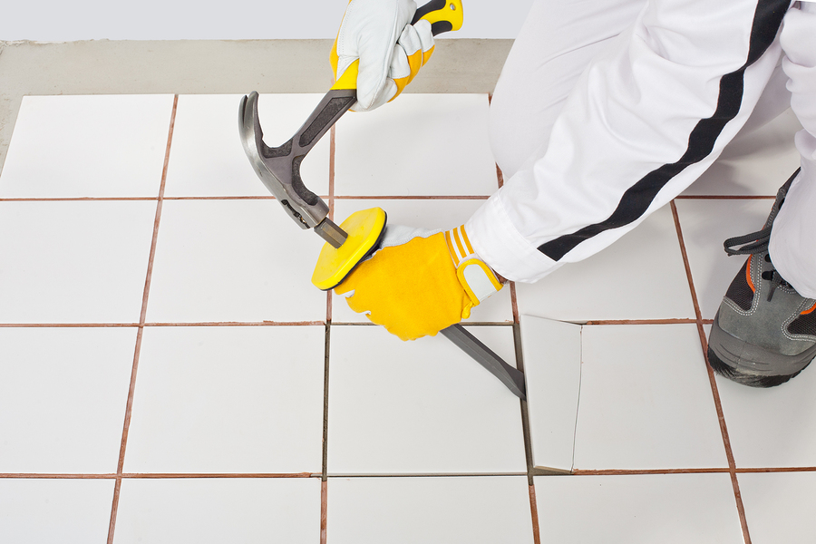 a professional tile remover removing tiles